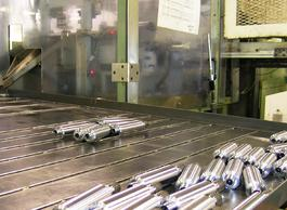 A photo of machined worm gears rolling off the line.