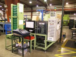 A photo of one of our automated part/lot number stamping machines.